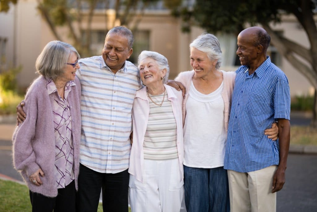 Group of older people laughing, sharing thoughts.